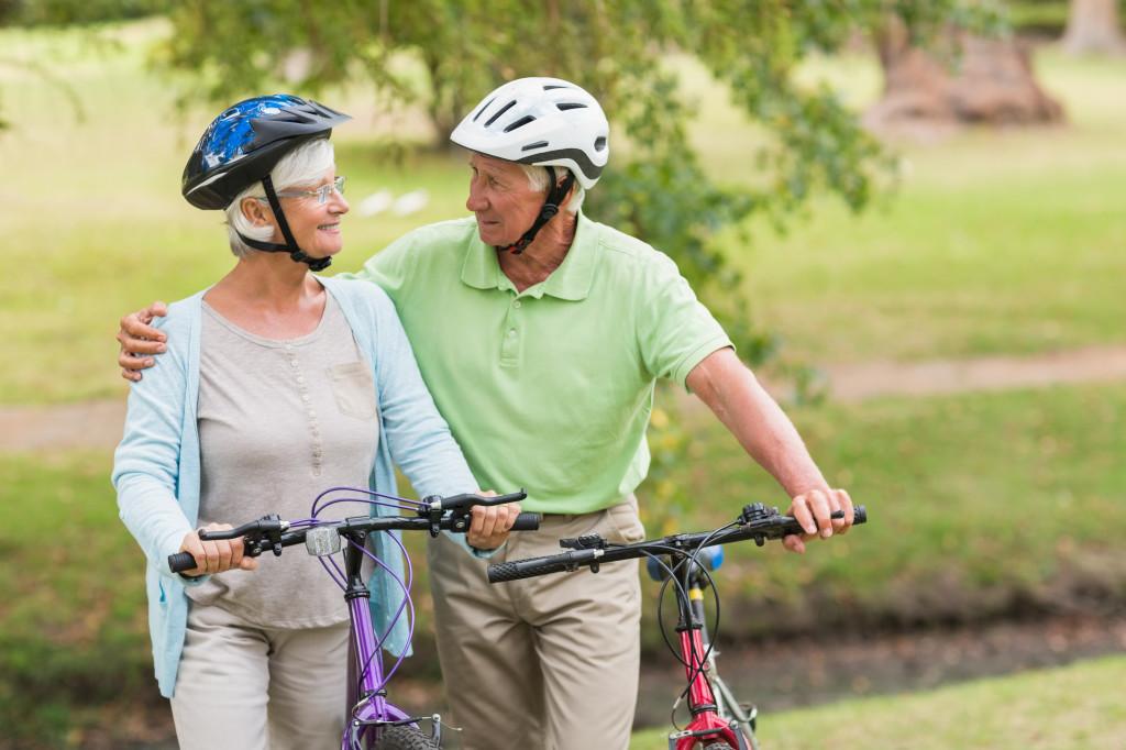 Happy senior couple on their bike on a sunny day